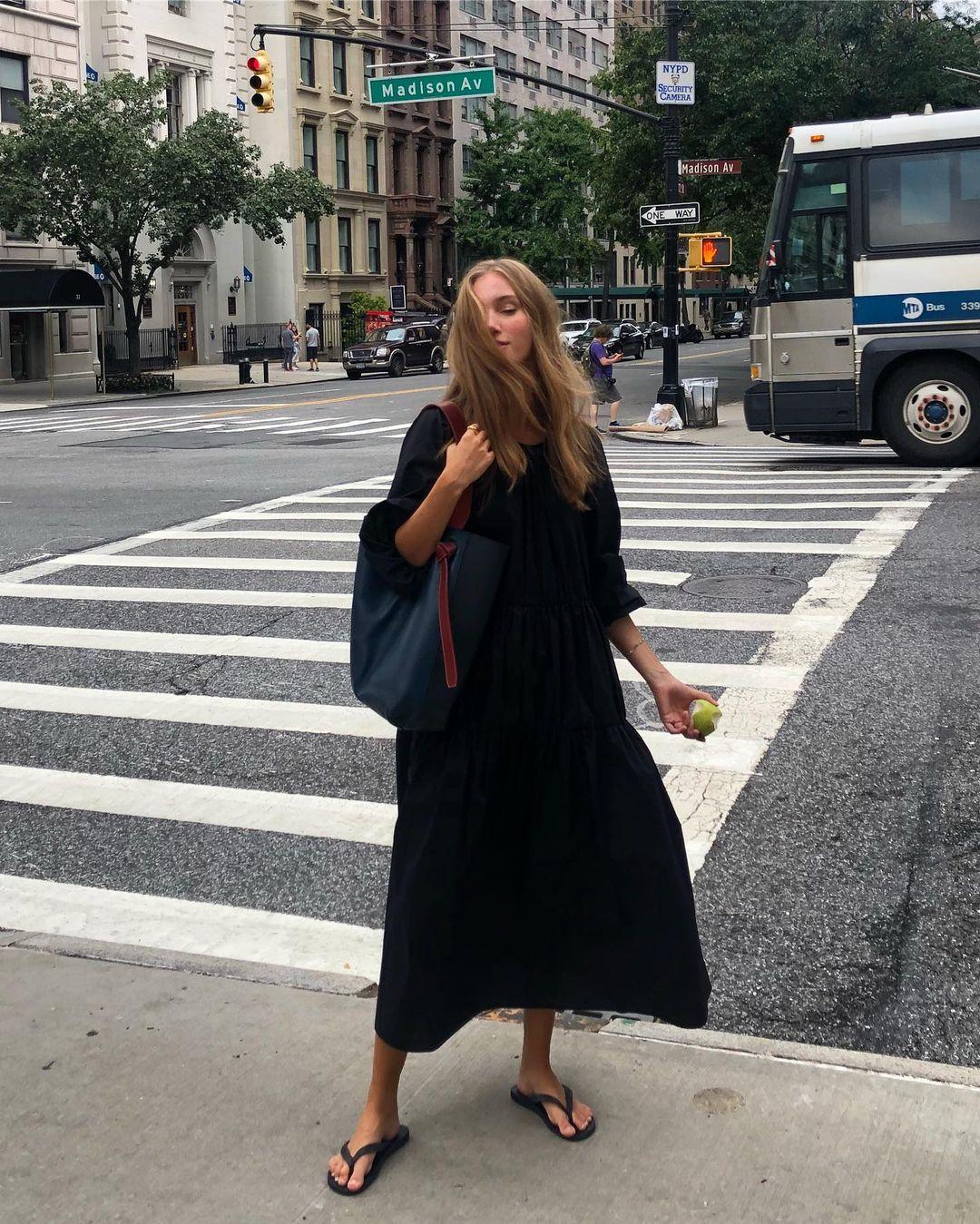 Stylish Easy Summer Outfit Idea —Amalie Moosgaard Neilsen in a black puff sleeve midi dress and black flip flops