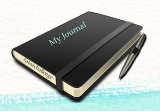 image journal with pen, #atozchallenge text on side of the journal