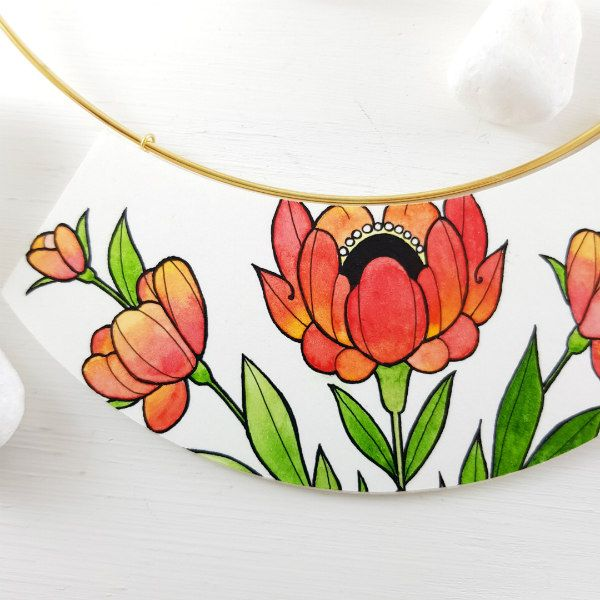 Tattoo style hand-painted orange and green floral paper pendant on necklace chain