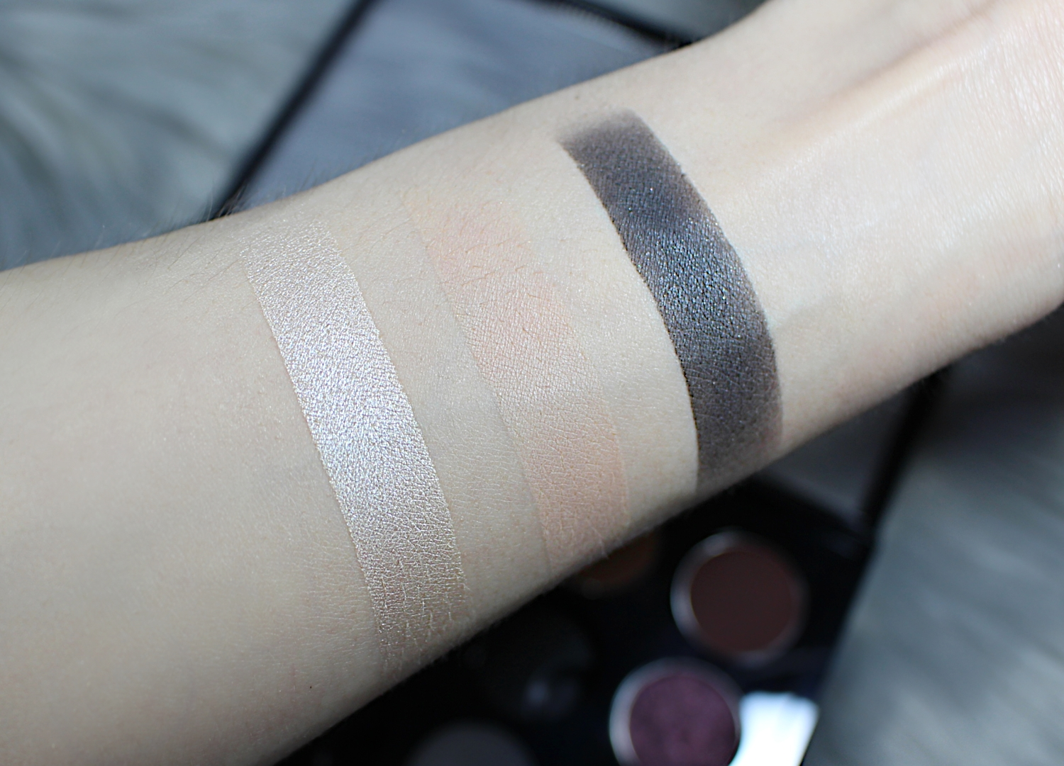 maccosmetics single eyesahdows in shades brule nylon and print are swatched on the skin
