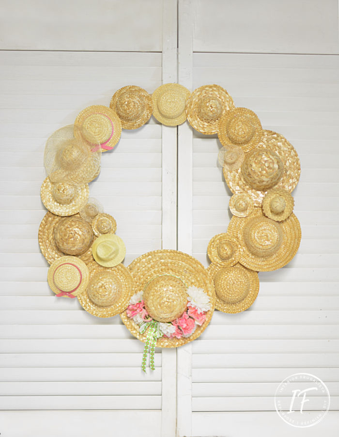 An easy DIY Summer Hat Wreath idea with recycled miniature straw hats. A budget-friendly summer craft idea with thrift store and dollar store finds.