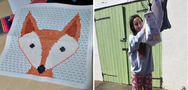 My finished fox cross stitch and my teen hanging the washing out
