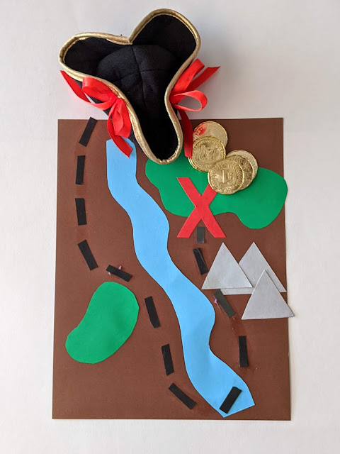 DIY pirate treasure map with pirate hat and gold plastic coins