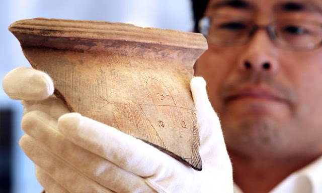 Ancient pottery fragment depicting female shaman found in Japan