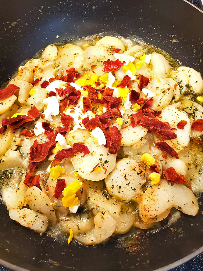 a salad with a vinegar creamy dressing with bacon called German Potato Salad