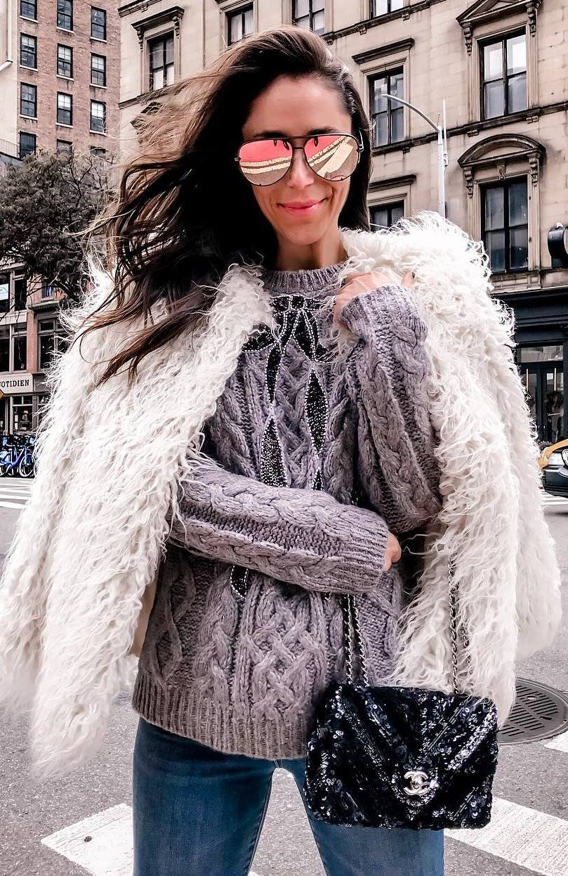 winter fashion trends / fur jacket + grey sweater + skinnies + glitter bag