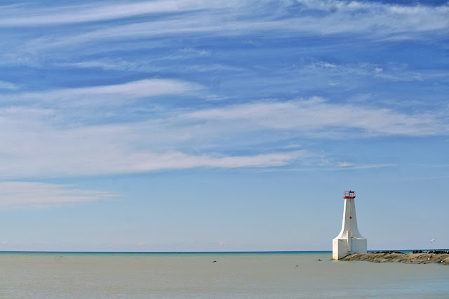 The Cobourg lighthouse at the end of the local pier...