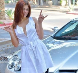 Picture of Raegan Brogdon with a car