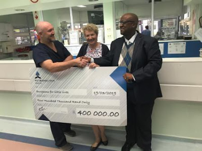 Cheque being handed over: Dr Chris Westgarth-Taylor, Ms Elsa Taylor, Dr Solly Motuba