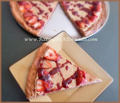 Peanut Butter and Jelly Dessert Pizza | recipe developed by www.BakingInATornado.com | #recipe #dessert