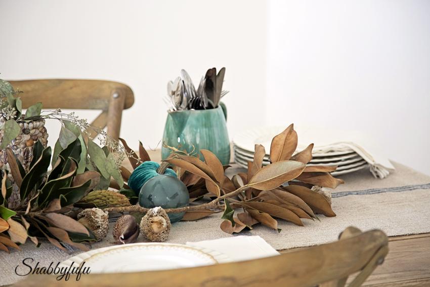 magnolia garland table setting.jpg