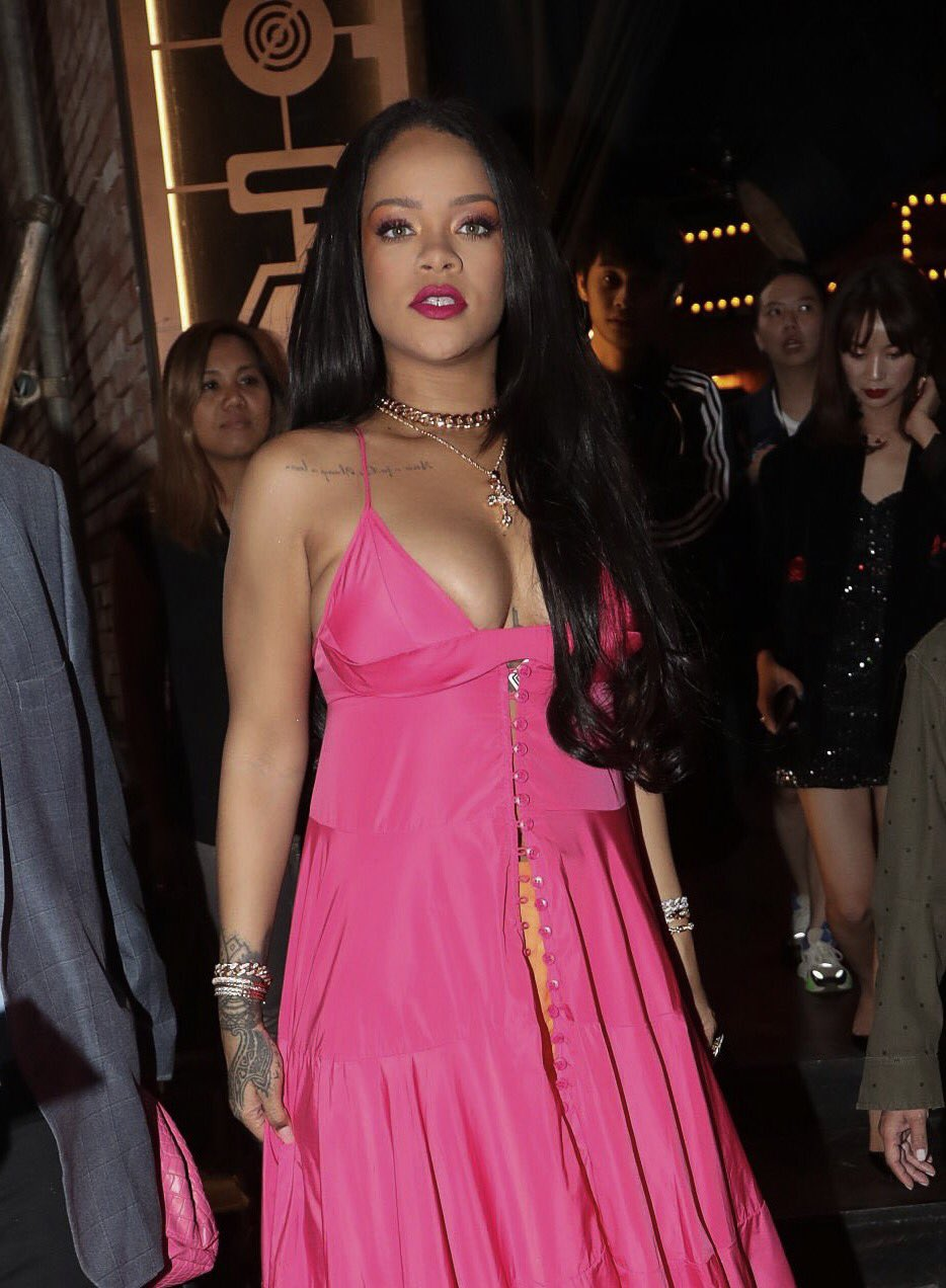 Rihanna nearly spills out of her pink maxi dress when promoting her Fenty makeup line in South Korea