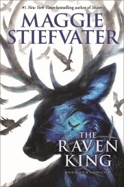 Cover of The Raven King, featuring the stormy blue silhouette of an Irish Elk surrounded by ravens in flight.