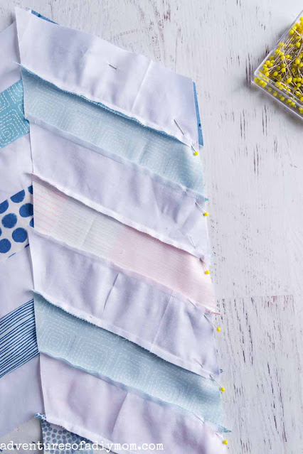 pinning together two columns of fabric