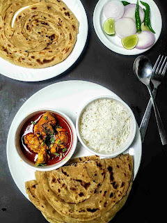 Serving wheat parotta with curry