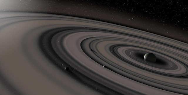 Artist's conception of the extrasolar ring system circling the young giant planet or brown dwarf J1407b. The rings are shown eclipsing the young sun-like star J1407, as they would have appeared in early 2007.  Credit Ron Miller