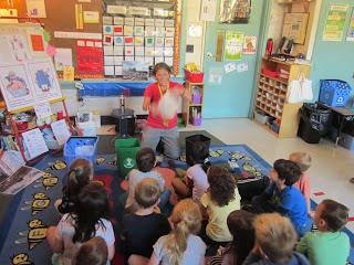 Recycle Rhonda teaching kindergartners about composting and recycling.