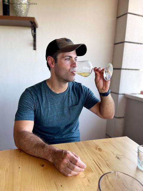 Handsome man drinking white wine