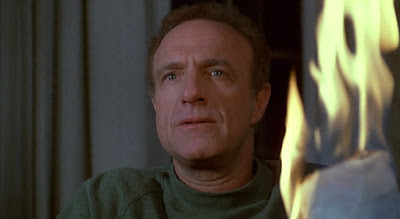 James Caan burns his latest novel in a still for the 1990 Stephen King classic Misery