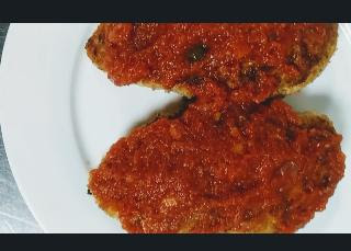 Chicken breasts topped with tomato sauce for healthy chicken parmesan recipe