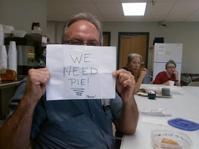 nursing home resident holding up we need pie sign