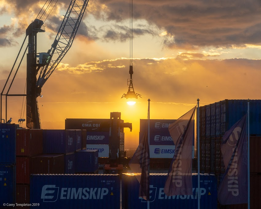 Portland, Maine USA December 2018 photo by Corey Templeton. The crane at the Eimskip terminal framing the rising sun.