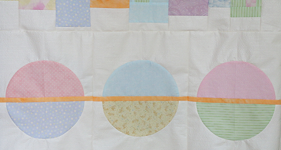 Detail of Circle Blocks from Mystery Quilt in Pastel Colors