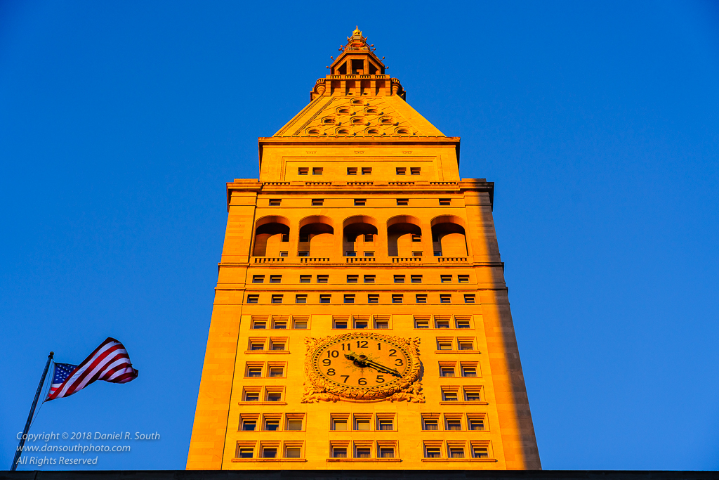 a photo of a midtown clock tower shot in the warm light of late december