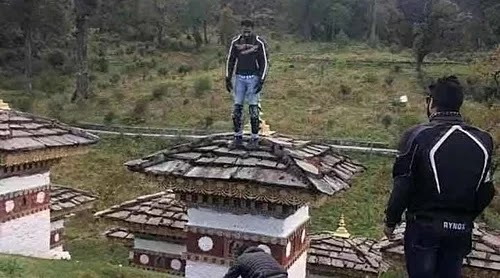 Male guests were arrested for climbing Buddhist stupas