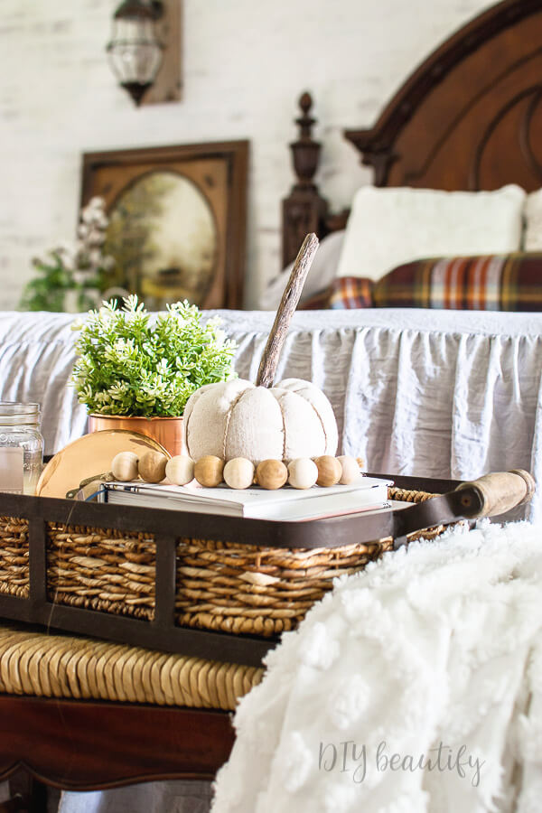 drop cloth pumpkin in basket on bed