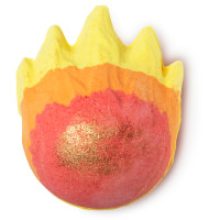 A spherical brown bath bomb with yellow and red pointed spikes to create flames around it on a bright background