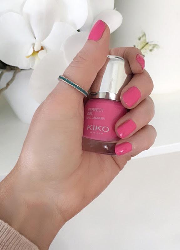 female hand holding nail polish bottle