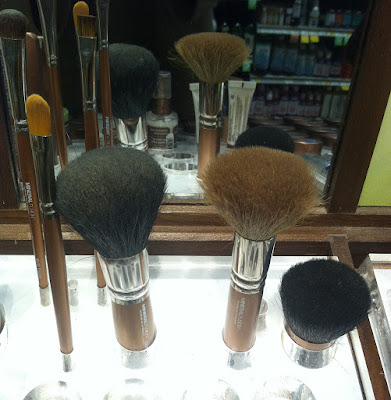 Brushes at a mass market beauty location that are obviously unclean.  Makeup brushes harbor bacteria when they are not sanitized properly.