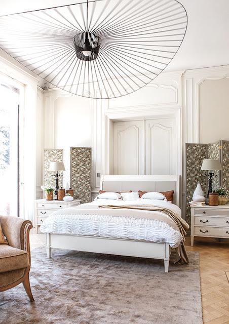 White bedroom with parquet floor and constance guisset light fixture