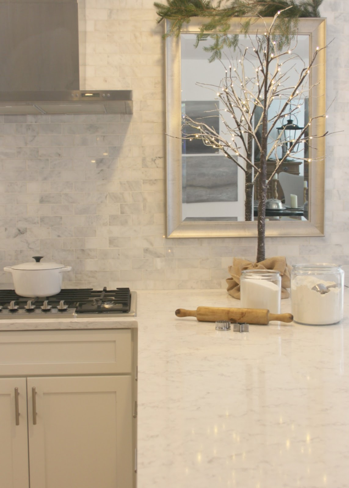 White kitchen with Minuet Viatera quartz countertop, mirror, and Christmas decor. Come be calmed by How to Freak Less About Holidays, Decorating and Gifts as well as Entertaining.