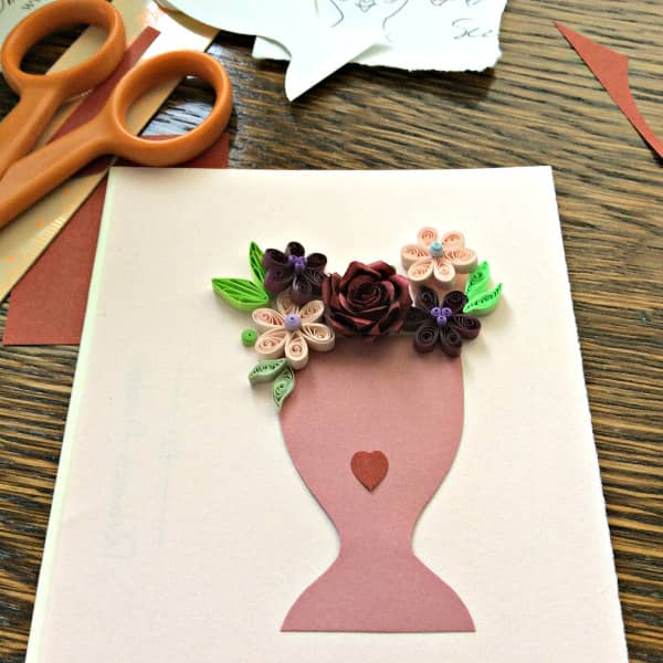 quilled lady vase card, layout in progress with scissors, ruler and paper supplies