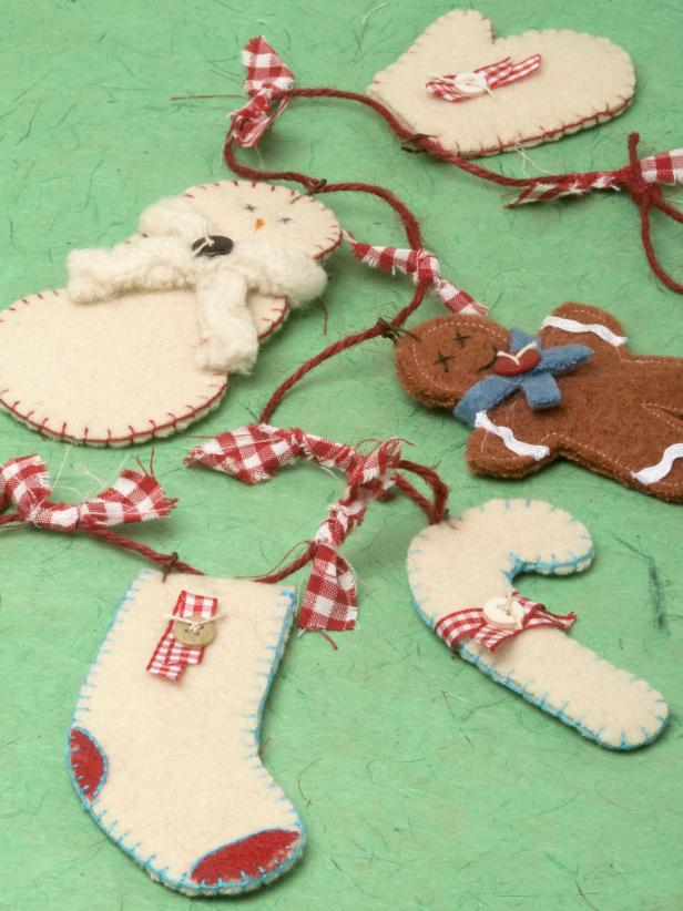 large piece of cream felt brown felt for the gingerbread man scissors pins permanent marker colored embroidery thread for blanket stitching and features - Felt Christmas Garland