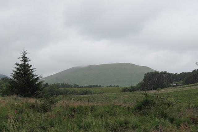The summit of Craig Cwm Cynywn below heavy cloud.
