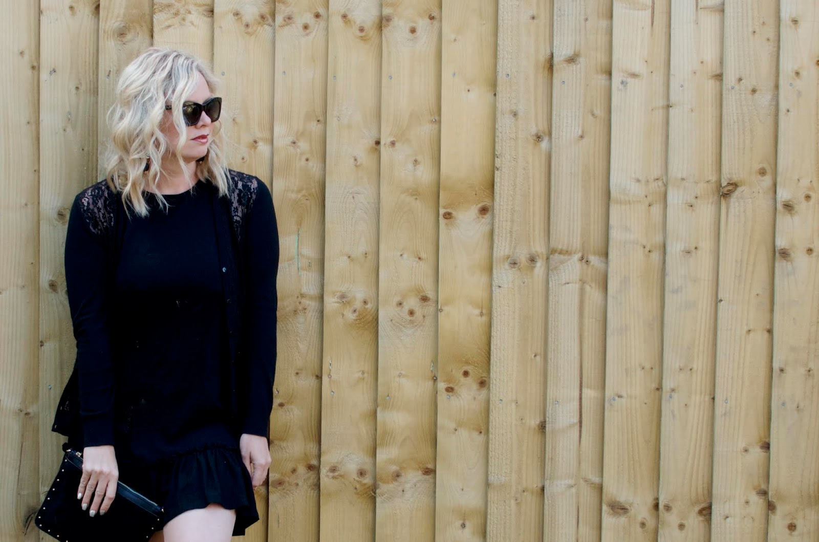 black cotton minidress with ruffle hem