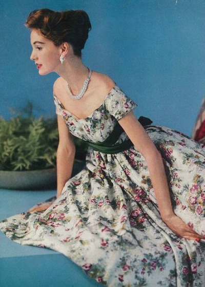 Model posed in flower print dress for 1957 Vogue