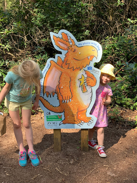Sisters posing next to a picture of Zog at the end of Thetford Forest Zog trail