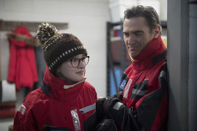 Where'd You Go, Bernadette (2019) movie still where Emma Nelson and Billy Crudup sneakily watch Cate Blanchett create her masterpiece