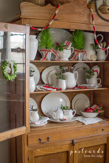 vintage oak hutch with ironstone dishes