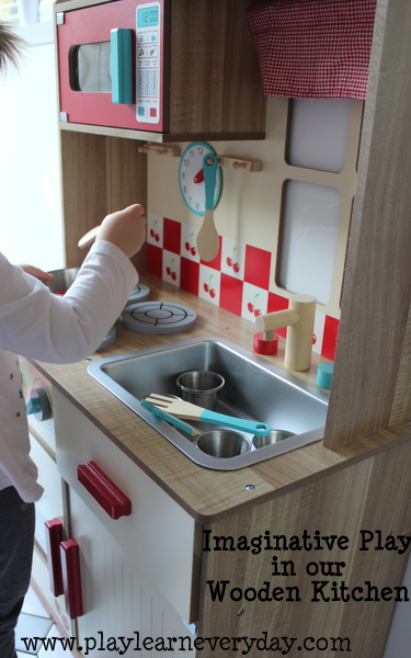 Imaginative Play In Our Wooden Kitchen Play And Learn