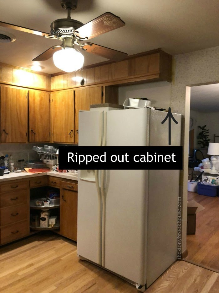 Removed cabinet above fridge
