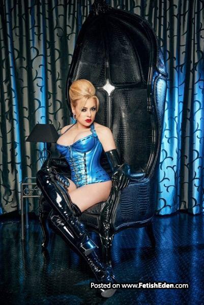 Blue latex corset blonde Monika Rose in long black latex gloves wears black PVC overknee boots