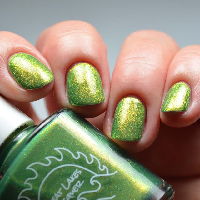 green shimmer nail polish swatch different angle