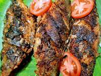 Crisp golden bangda(Mackerel) fish tawa fry recipe is serving