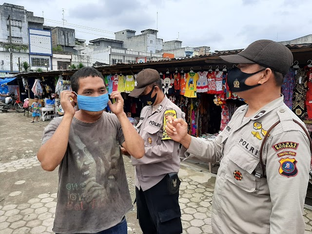 Kasat Binmas AKP Syafi'i Polres Batu Bara Lakukan Ops Yustisi di Pajak Delima Kelurahan Indrapura
