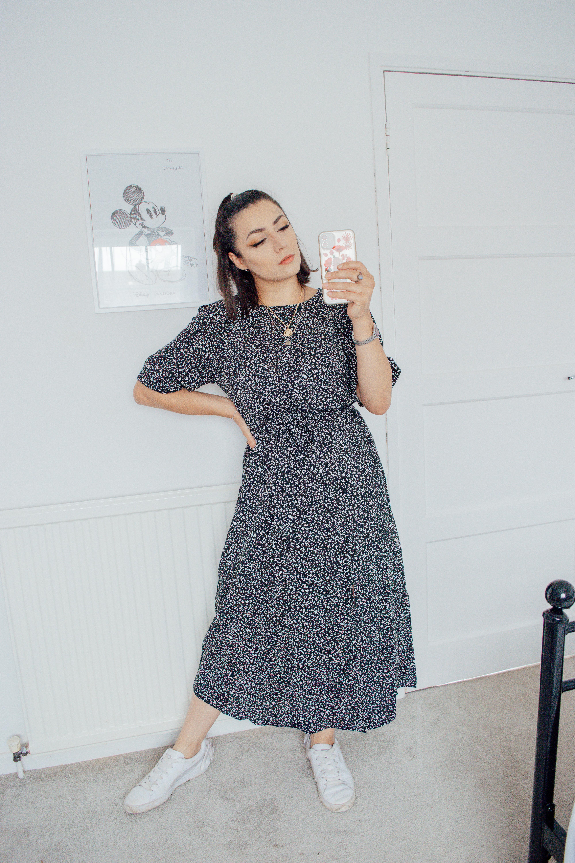 Girl wearing a black floral midi dress